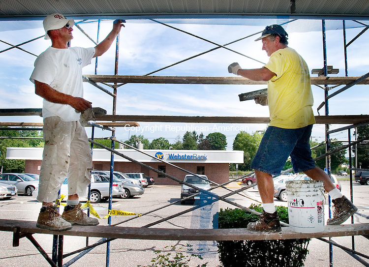 WATERTOWN, CT. 28 June 2010-062810SV03--From left, Wesley Kon and Peter Piotrucha of Wall Systems build a stucco facade on the Pioneer Plaza, while trying to stay out of the sun, in Watertown Monday.<br /> Steven Valenti Republican-American