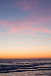 A southern California seascape with multi-colored cirrus clouds at sunset in Malibu, California, USA
