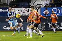 Garry Thompson of Wycombe Wanderers (left) shoots during the Sky Bet League 2 match between Luton Town and Wycombe Wanderers at Kenilworth Road, Luton, England on 26 December 2015. Photo by David Horn.