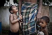 Children of Santu Usenti gather around him in Godhari village in Orcha block of Chattisgarh, India. Photo: Sanjit Das