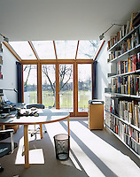 Sunlight pours in through the conservatory extension to this home office space