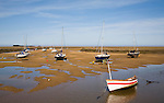 Boats at low tide at Wells next the Sea, Norfolk, England