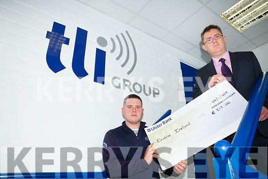Aaron O'Mahony of TLI Abbeydorney presented  a cheque for €819 to Sean Scally of  Enable Ireland proceeds of a fundraiser