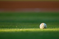 A Rawlings practice baseball sits in the grass prior to the start of the International League game between the Toledo Mud Hens and the Charlotte Knights at Knights Stadium on May 10, 2012 in Fort Mill, South Carolina.  (Brian Westerholt/Four Seam Images)