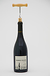 A bottle of Gramercy Cellars 2005 Syrah on a white background