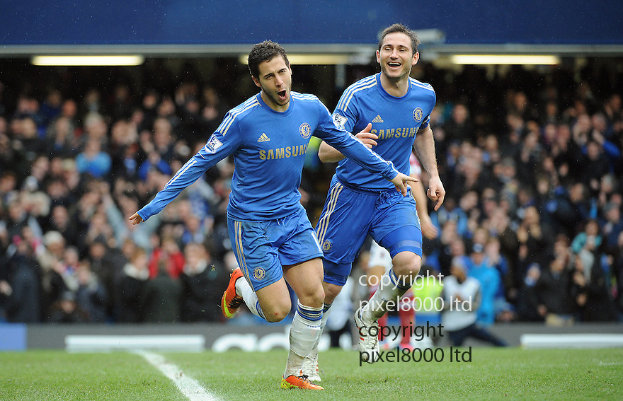 Eden Hazard of Chelsea celebrates a goal with teams during the Barclays Premiere League match between Chelsea and West Ham United at Stamford Bridge on Sunday March 17, 2013 in London, England Picture Zed Jameson/pixel 8000 ltd.