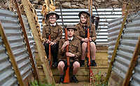 BNPS.co.uk (01202 558833)<br /> Pic: PhilYeomans/BNPS<br /> <br /> l-r Jake, Mae and Martina - students of Garth Hill College in Bracknell get used to life in the trenches.<br /> <br /> Class War - A school has turned part of its playground into a replica First World War trench system that makes an fascinating and poignant living history classroom.<br /> <br /> The scaled down trenches allows pupils to get an authentic, hands-on lesson on what life and conditions were like for the unfortunate soldiers who served on the Western Front. <br /> <br /> As well as being given educational talks, students also get muddy taking part in re-enactment demonstrations in the trenches. <br /> <br /> The attention to detail includes replica rifles, bayonets, shell casings and even models of the ever present rats.<br /> <br /> The outdoor classroom is the first of its kind in the country and schools from miles around are booking up visits for their students to experience the real feel of the award winning movie 1917.