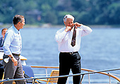 President Boris Yeltsin of the Russian Federation, right, removes his tie as he and United States President George H.W. Bush, left, take a boat ride on the Severn River in Maryland on June 17, 1992. <br />