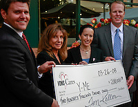 Daymond Rice of VONS and District 2 councilman Kevin Faulconer present a check to Rita Hopkins (L) and Dr Julie Barone of the Y-Me Breast Cancer Organization at the Liberty Station Vons, in San Diego, CA Wednesday March 26, 2008.