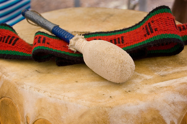 The Hopi played traditional songs using Pueblo drums made from cottonwood tree trunks stretched with animal hide as a musical instrument to keep a strong beat for singing and dancing