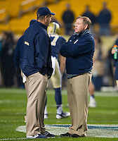 Head coach Brian Kelly chats with Pittsburgh Panthers head coach Paul Chryst before the game.