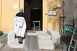 Europe Virus Outbreak - Cemetery Works in Pergine Valsugana, Italy on April 21, 2020. A sweeping lockdown is in place in Italy to try to slow down the spread of coronavirus pandemic. Employees wearing gloves and masks puts away is PPE.