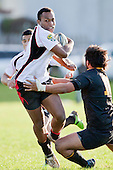 Seremaia Tagicakibau tries to break through the tackle of Kelly Haimona. Counties Manukau Steelers pre season ITM Cup game against a Bay of Plenty Wasps selection, played at Moore Park Katikati, on July 7th 2010.