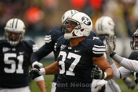 Trent Nelson  |  The Salt Lake Tribune.BYU defensive lineman Vic So'oto (37) celebrates a defensive stop in the first quarter. BYU vs. Wyoming, college football Saturday, October 23, 2010 at LaVell Edwards Stadium in Provo.