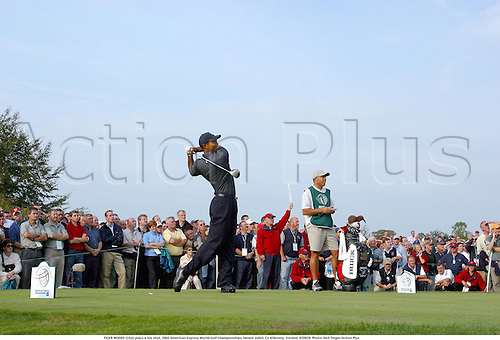 TIGER WOODS (USA) plays a tee shot, 2002 American Express World Golf Championships, Mount Juliet, Co Kilkenny, Ireland, 020920. Photo: Neil Tingle/Action Plus...golf golfer player.....................