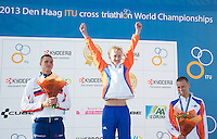 13 JUL 2013 - DEN HAAG, NED - Cornelis Scheltinga (NED) (centre) of the Netherlands celebrates winning the 2013 ITU Under 23 Men's Cross Triathlon World Championships in Kijkduin, Den Haag (The Hague), the Netherlands, flanked by silver medalist Tomas Kubek (SVK) (left) of Slovakia and bronze medalist Jarrich Van Woersem	(NED) (right) of the Netherlands (PHOTO COPYRIGHT © 2013 NIGEL FARROW, ALL RIGHTS RESERVED)