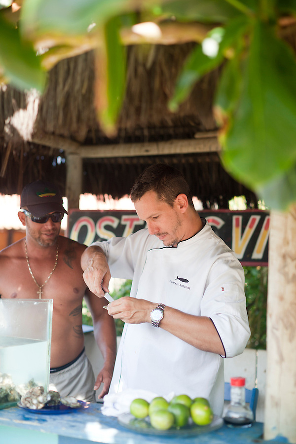 Chef Gustavo Rinkevich shucking oysters at Rocka Beach Lounge and Restaurant.