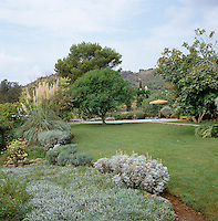 The planting in this garden, designed originally by Cecil Beaton, combines varying shades of grey and green to create texture and contrast