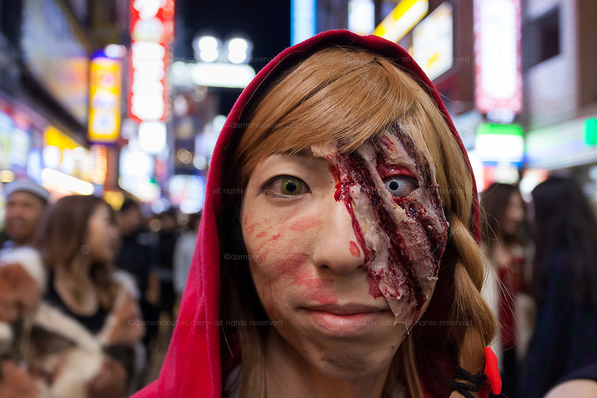 A young Japanese woamn dressed as Red Riding Hood mauled by a wolf enjoys the Halloween celebrations in Shibuya. Saturday October 28th 2017