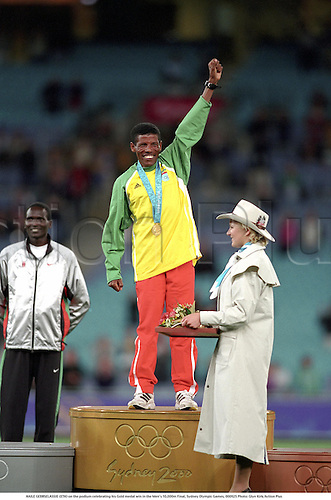 HAILE GEBRSELASSIE (ETH) on the podium celebrating his Gold medal win in the Men's 10,000m Final, Sydney Olympic Games, 000925 Photo: Glyn Kirk/Action Plus...2000 athletics athlete distance runner podiums rostrum rostrums medals winner winners celebration celebrating celebrate celebrates joy presentation