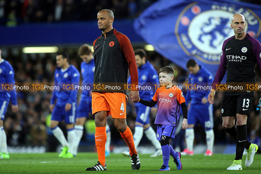 Vincent Kompany leads out the Manchester City team during Chelsea vs Manchester City, Premier League Football at Stamford Bridge on 5th April 2017
