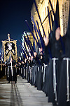 Row of penitents bearing candles and the brotherhood banner, Holy Week 2008, Seville, Spain