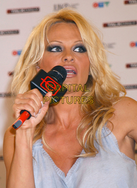 PAMELA ANDERSON.The 35th Annual JUNO Awards Press Conference, held at the Delta Halifax, Halifax, Nova Scotia, Canada,.01 April 2006..half length microphone.REF: ADM/GS.www.capitalpictures.com.sales@capitalpictures.com.©George Shepherd/AdMedia/Capital Pictures.