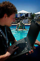 TRANSEC Sonar Test Basin, Point Loma, San Diego, CA, USA. Friday, August 1 2008.  Virgina Chu of Georgia Tech holds her teams Autonomous Underwater Vehicle in a test pool next to the site of the 2008 AUVSI competion while teamate Nate Tinkler communicates with it via his laptop computer.