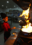 A Palestinian boy chef, Mohammed Abu Nada ,12, cooks the western meals at a restaurant in Gaza City on October 3, 2018. Photo by Mahmoud Ajjour