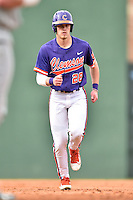 Clemson Tigers right fielder Seth Beer (28) runs back to first during a game against the South Carolina Gamecocks at Fluor Field on March 5, 2016 in Greenville, South Carolina. The Tigers defeated the Gamecocks 5-0. (Tony Farlow/Four Seam Images)