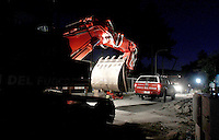 A crane makes its way at night past rubble of collapsed buildings in the village of Amatrice, central Italy, hit by a magnitude 6 earthquake at 3,36 am, 24 August 2016.<br /> Una gru al lavoro di notte tra le macerie degli edifici crollati dopo il terremoto che alle 3,36 del mattino ha colpito Amatrice, 24 agosto 2016.<br /> UPDATE IMAGES PRESS/Isabella Bonotto