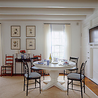 Vintage chairs surround the Crate and Barrel table in the dining area of the family room.