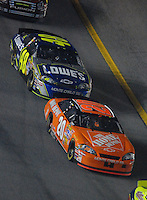 Feb 10, 2007; Daytona, FL, USA; Nascar Nextel Cup driver Tony Stewart (20) leads Jimmie Johnson (48) during the Budweiser Shootout at Daytona International Speedway. Mandatory Credit: Mark J. Rebilas