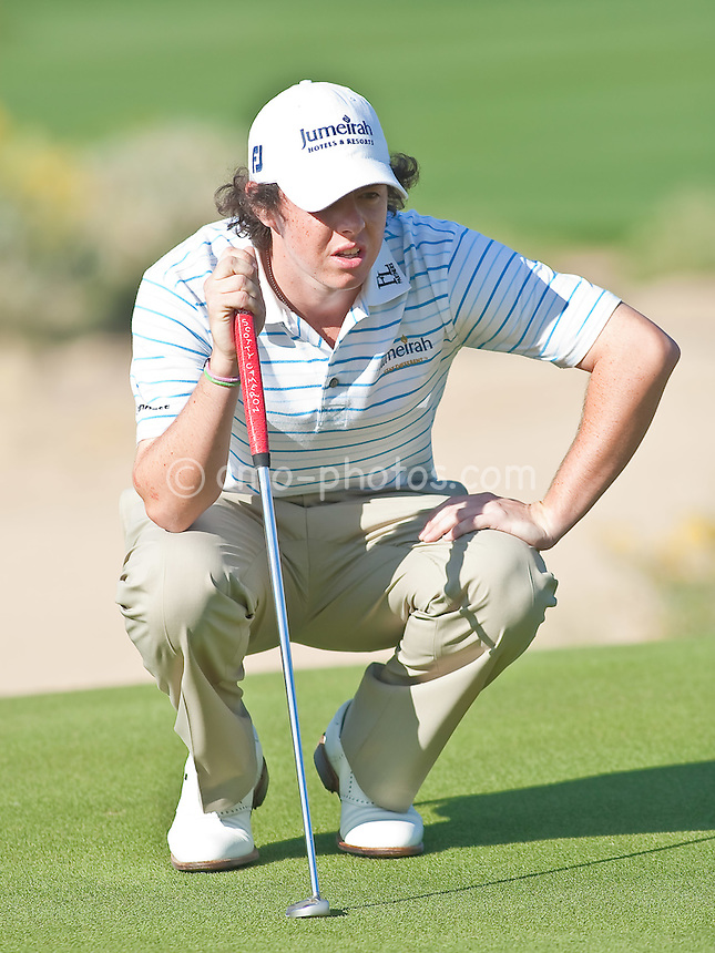 Feb 26, 2009; Marana, AZ, USA; Rory McIlroy (XNI) examines a putt on the 17th hole during the second round of the World Golf Championships-Accenture Match Play Championship at the Ritz-Carlton Golf Club, Dove Mountain.