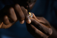 Nils, 24 years old, Quiza ( a mixture of cocaine and other drugs, smoked like crack ) addict, smokes a dose of drugs in a compound of a very poor neighborhood in Bissau, Guinea Bissau on Sunday  Sept 16 2007.///..Guinea Bissau is infamous for its cocaine trafficking. in 2005 Colombian cartels begun to arrive in the country transforming it into a Narco State. Up to 5 tons of pure cocaine are estimated to be arriving in the country every week. Guinea Bissau is the 5th poorest country in the world, making it the ideal transit base for the cocaine that will finish on the european markets. Corruption and involvement in the trafficking are present at every level of its institutions..Guinea Bissau is only one of the countries in West Africa involved in cocaine trafficking. Tons of Cocaine have been seized in Nigeria, Senegal, Ghana and  Sierra Leone.