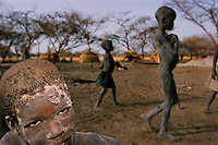 "Living in the dust.In war torn southern Sudan, boys who have only leaves to eat, pack mud onto their hair to kill lice...Story Summary:.Sudan, the largest country in Africa, hosts a civil war between the Islamic North and the African South that has the highest casualty rate of any war since World War II...Two and a half million people have been killed in this insidious conflict.  It drags on because Southerners have no voice, and the Northerners have engineered ""The Perfect War"" where none of their people are killed...The North forces people out of the South by bombing them, burning their crops, and harassing them with gunships. They abduct their children and draft them to fight with the Northern army--forcing southerners to fight their own brothers...This story is particularly interesting now because there is a small window for peace in a civil war that has been dragging on since the end of colonial rule.  The war has always been about tribal issues and ideology... but more than that, it is about resources.  This clash over resources may bring peace.  The North controls the pipeline and the only port, and the South controls the land...The story of Sudan has always been the continual transference of wealth from the resources of the south to the elite few who live in the deserts of the north.  And the sucking sound in the middle of the country is from the corrupt government in northern Khartoum.."