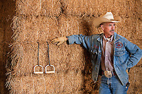 Murray Thompson, World Champion Reined Cow Horse on his ranch in California in the hay barn