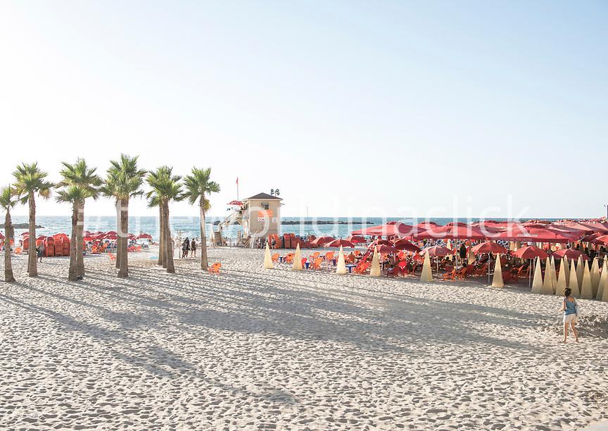 ISRAEL, Tel Aviv, a woman is walking in Frishman Beach