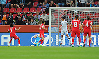 Jessica Clarke (l) of team England scores 2:1 during the FIFA Women's World Cup at the FIFA Stadium in Dresden, Germany on July 1st, 2011.