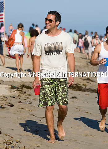 """CASH WARREN.celebrates Independence Day on Malibu beach. Malibu_04/07/2009.Mandatory Photo Credit: ©Dias/Newspix International..**ALL FEES PAYABLE TO: """"NEWSPIX INTERNATIONAL""""**..PHOTO CREDIT MANDATORY!!: NEWSPIX INTERNATIONAL(Failure to credit will incur a surcharge of 100% of reproduction fees)..IMMEDIATE CONFIRMATION OF USAGE REQUIRED:.Newspix International, 31 Chinnery Hill, Bishop's Stortford, ENGLAND CM23 3PS.Tel:+441279 324672  ; Fax: +441279656877.Mobile:  0777568 1153.e-mail: info@newspixinternational.co.uk"""