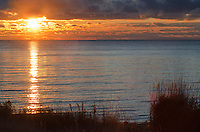 The sun glows over Newport Bay on Lake Michigan at Newport State Park in Door County, Wisconsin