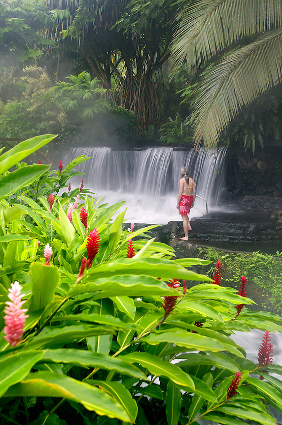 A visitor (mr) enjoys a hot water stream flows through Tabacon Hot Spring Resort and Spa Costa Rica