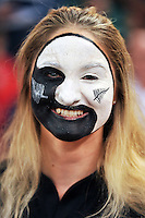 A New Zealand supporter in the crowd shows off her face paint. Rugby World Cup Pool C match between New Zealand and Georgia on October 2, 2015 at the Millennium Stadium in Cardiff, Wales. Photo by: Patrick Khachfe / Onside Images