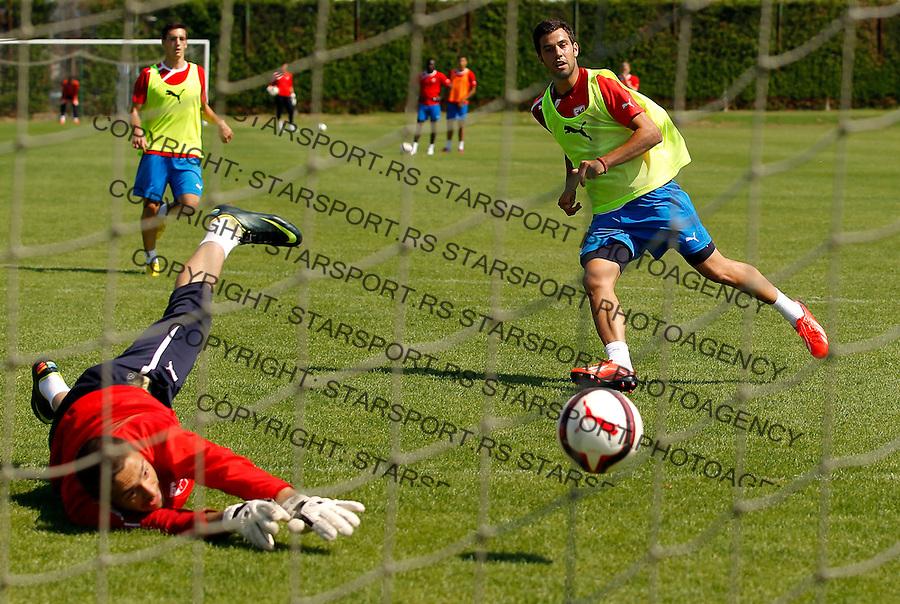 Fudbal season 2012-2013<br /> FK Crvena Zvezda pripreme<br /> Luka Milivojevic and golakeeper Milos Vesic<br /> Brezice, 27.06.2013.<br /> foto: Srdjan Stevanovic/Starsportphoto &copy;