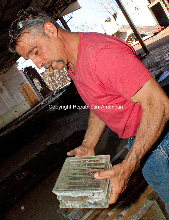 WATERBURY CT- 14 MARCH 2011-031412DA02- Owner of C&D Services in Wolcott, Carl  Begley holds one of about five hundred   blocks that was once part of  windows  inside of the old Matthew's & Willard in Manufacturing Co. on Cherry St in Waterbury and will be recycled.DARLENE DOUTY REPUBLICAN AMERICAN