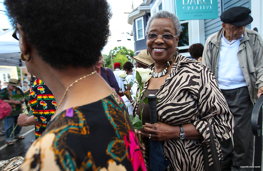 Portsmouth N.H., Sunday, Aug. 17, 2014:  Royaline Edwards of Kittery holds a white rose after the ceremony.  Members of the African Burying Ground Memorial committee held a ceremony to consecrate the the site of buried slaves. (Portsmouth Herald Photo Cheryl Senter)