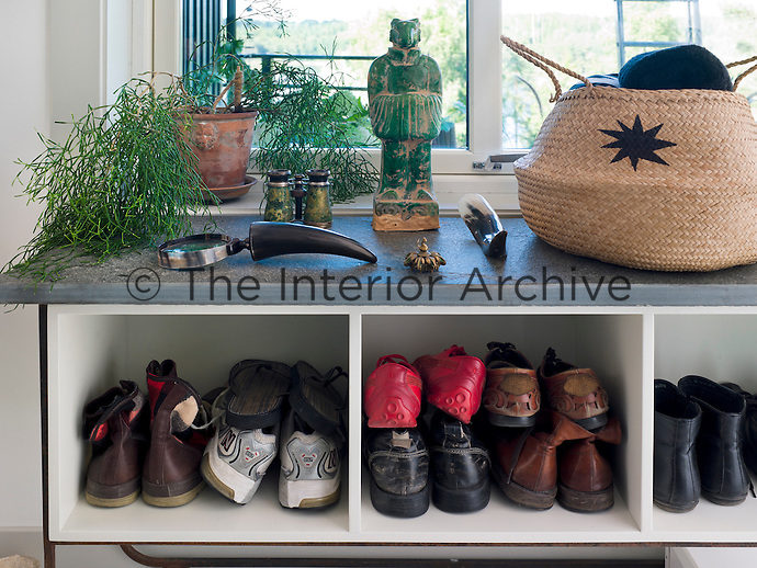 In the hall, shoes are stored in a sideboard made by Schoenning's grandfather