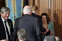 Speaker of the United States House of Representatives Nancy Pelosi (Democrat of California) holds the arm of US President Donald J. Trump during the Friends of Ireland luncheon with Leo Varadkar, Ireland's prime minister at the U.S. Capitol in Washington, D.C., U.S., on Thursday, March 14, 2019. <br /> Credit: Olivier Douliery / Pool via CNP/AdMedia