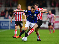Crewe Alexandra's Perry Ng is tackled by Lincoln City's Shay McCartan<br /> <br /> Photographer Chris Vaughan/CameraSport<br /> <br /> The EFL Sky Bet League Two - Lincoln City v Crewe Alexandra - Saturday 6th October 2018 - Sincil Bank - Lincoln<br /> <br /> World Copyright &copy; 2018 CameraSport. All rights reserved. 43 Linden Ave. Countesthorpe. Leicester. England. LE8 5PG - Tel: +44 (0) 116 277 4147 - admin@camerasport.com - www.camerasport.com