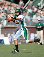 Andy Schmitt (Eastern Michigan U. Quarterback) is flushed out of the hole by the Ohio defense. Ohio won their Homecoming game 48 42..Eastern Michigan Football vs. Ohio University, 10 13 2007